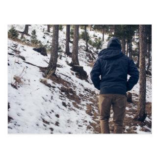 Man walking on a narrow passage postcard