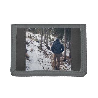 Man walking on a narrow passage tri-fold wallet
