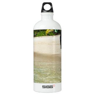 Man walking through shallow surf water bottle