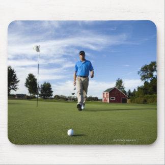 Man walking towards his golf ball. mouse pad