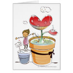 Man watering a potted plant greeting card
