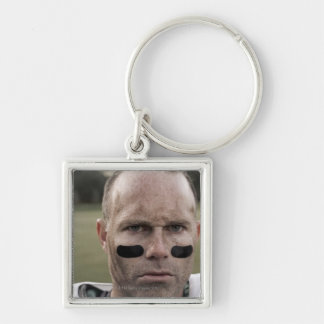 Man wearing American football kit, high section, Keychain