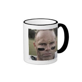 Man wearing American football kit, high section, Mug