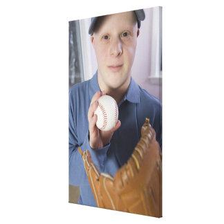 Man with a baseball glove and a baseball canvas print