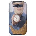 Man with a baseball glove and a baseball galaxy SIII case