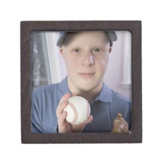 Man with a baseball glove and a baseball gift box