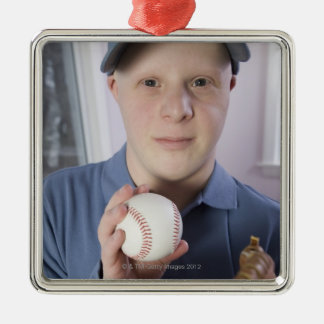 Man with a baseball glove and a baseball metal ornament