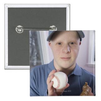 Man with a baseball glove and a baseball pinback button