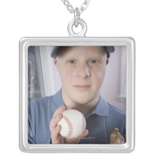 Man with a baseball glove and a baseball square pendant necklace