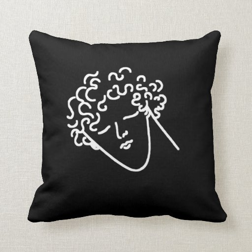 man with curly hair black pillow