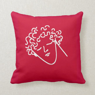 man with curly hair red pillows