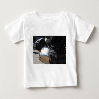 Man with kilt playing on drums baby T-Shirt