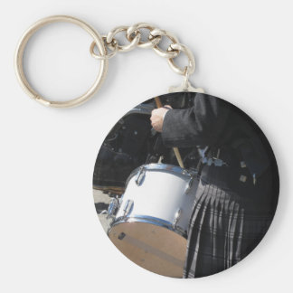 Man with kilt playing on drums keychain