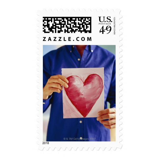 Man with painting of heart postage stamps