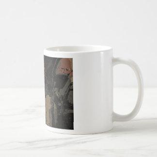 Man with protective mask on dark metal plate coffee mug