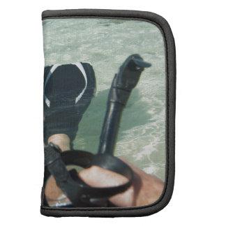 Man with snorkeling equipment folio planner