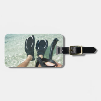 Man with snorkeling equipment tag for luggage