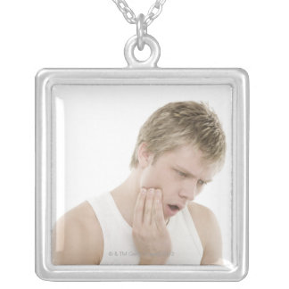 Man with toothache square pendant necklace