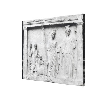 Man, woman and child before an altar canvas print