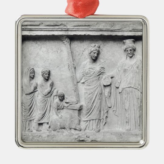 Man, woman and child before an altar metal ornament