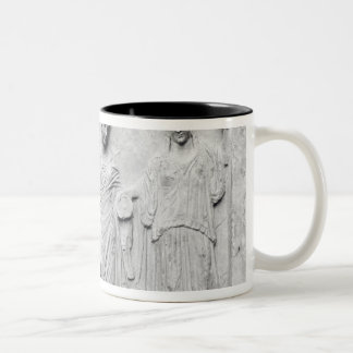Man, woman and child before an altar Two-Tone coffee mug