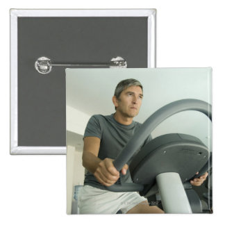 Man working out in a gym 2 inch square button