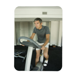 Man working out in a gym 2 rectangular photo magnet