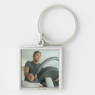 Man working out in a gym keychain