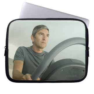 Man working out in a gym laptop computer sleeves