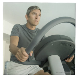 Man working out in a gym large square tile