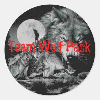 Manada de lobos del equipo pegatina redonda