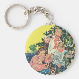 Mañana de navidad del vintage, niños que abren los llavero redondo tipo pin