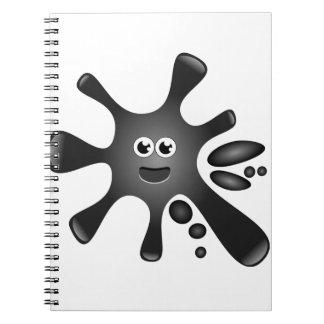 Mancha blanca negra de la tinta libro de apuntes