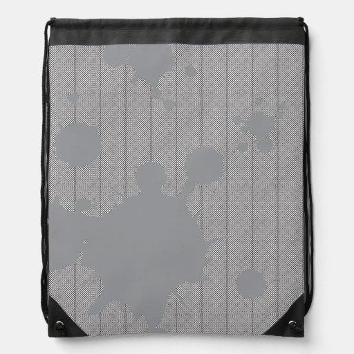 manchas grises mochila