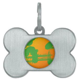 manchas verdes en naranja placa de nombre de mascota