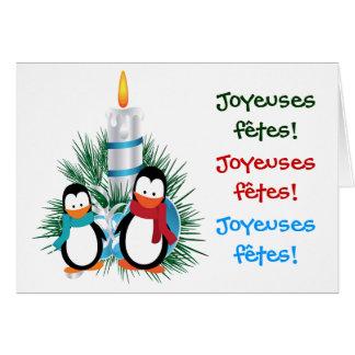 Manchots de Noël y cartas de la vela Tarjeta