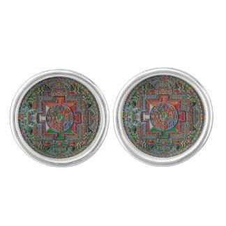 Mancuernas tibetanas de la mandala de la arena gemelos