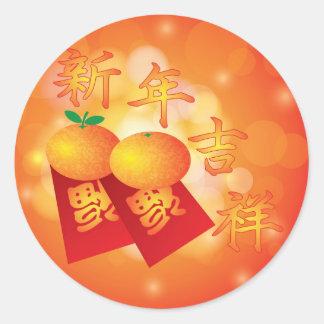 Mandarinas chinas del Año Nuevo y paquetes rojos Pegatina Redonda