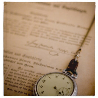 Mando antiguo del reloj de bolsillo del papel del servilletas imprimidas