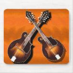 mandolins crossed on orange -MOUSEPAD