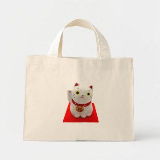 Maneki blanco Neko en una alfombra roja Bolsas De Mano