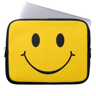 Manga feliz del smiley de la cara fundas computadoras