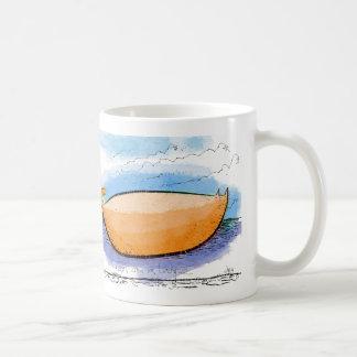 Mango shaped cat on a ledge coffee mug