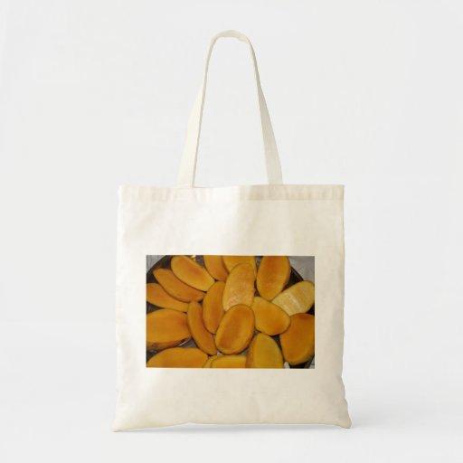 Mango slices tote bags