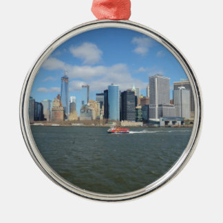 Manhattan in the distance. Silver-Colored round decoration