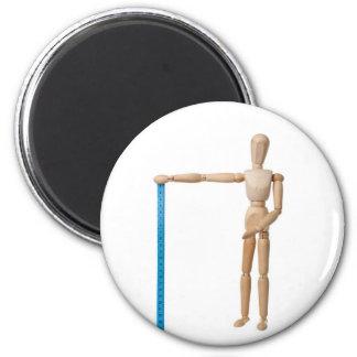 Maniquí que detiene a una cinta métrica imán redondo 5 cm