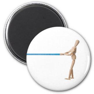 Maniquí que tira de una cinta métrica imán redondo 5 cm