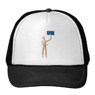 Mannequin holding business card trucker hat