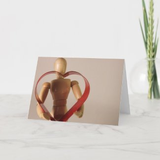 Mannequin holding heart card