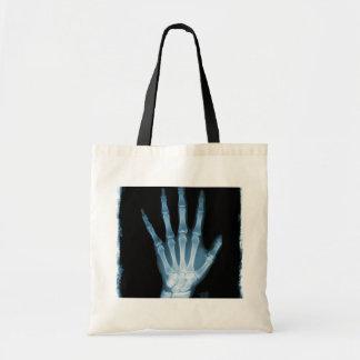 Mano azul del esqueleto de la radiografía bolsas